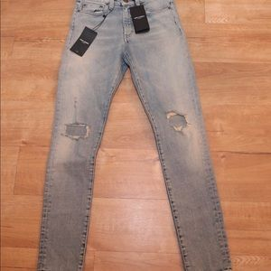 BRAND NEW SAINT LAURENT DISTRESSED JEANS